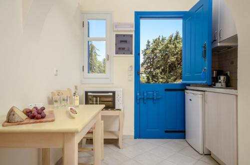 A kitchen or kitchenette at Orkos Blue Coast