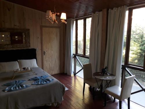 Cama ou camas em um quarto em Villa Valentina Chalés