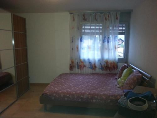 Ein Bett oder Betten in einem Zimmer der Unterkunft Gimmco Appartements