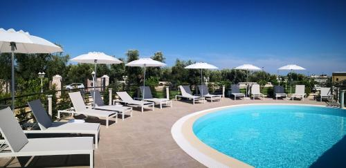 The swimming pool at or near Hotel Puglia Garden
