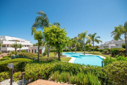 The swimming pool at or close to Ground floor apartment with private garden next to puerto Banús