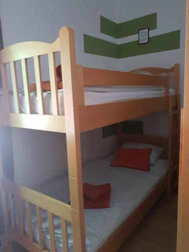 A bunk bed or bunk beds in a room at Hostel Scardona
