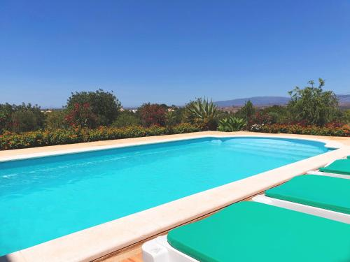 The swimming pool at or near Algarve Casa da Eira