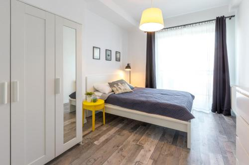 A bed or beds in a room at Arianska Residence
