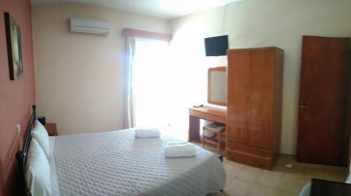 A bed or beds in a room at Manolia Studios