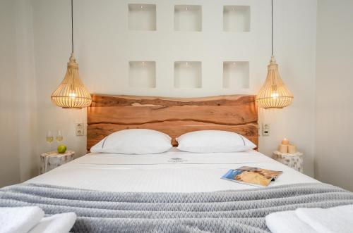 Ένα ή περισσότερα κρεβάτια σε δωμάτιο στο Africanis Suites