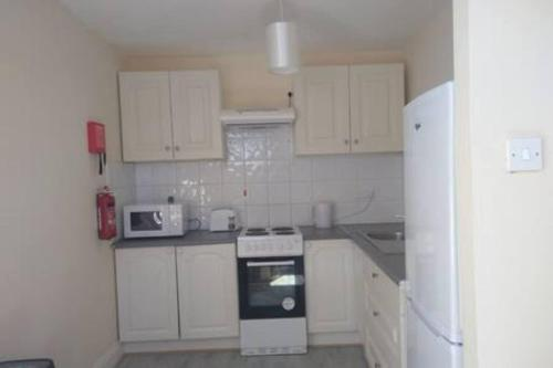 A kitchen or kitchenette at Dungarvan Town Centre Apt 3
