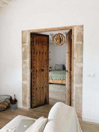 A bed or beds in a room at Sa Caseta