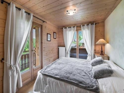A bed or beds in a room at Apartment Location appartement 4 pièces megeve centre village 1