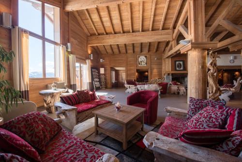 A seating area at CGH Résidences & Spas Le Village De Lessy