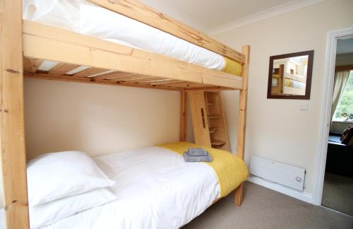 A bunk bed or bunk beds in a room at Afan Valley Escapes, Valley Views, The Nook, Sleeps 6