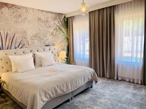 A bed or beds in a room at SZEWSKA 22 BOUTIQUE