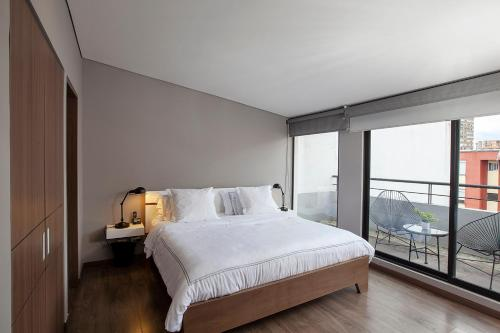 A bed or beds in a room at BOGO - 64