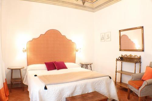 Voodi või voodid majutusasutuse BorgoDeiGreci Apartments toas