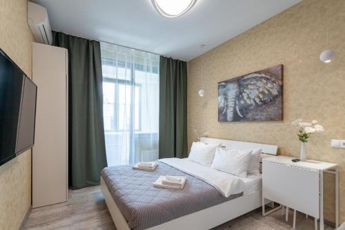 Кровать или кровати в номере Second house
