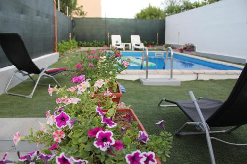 The swimming pool at or near Holiday Home Flora