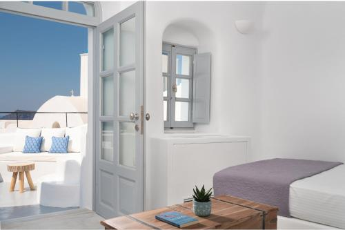 A bed or beds in a room at Oia Spirit Studios
