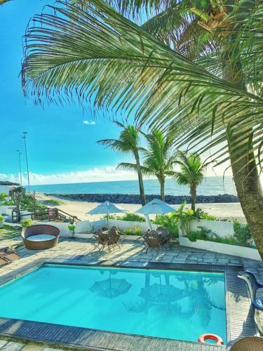 A piscina localizada em Hotel Paraíso Natal ou nos arredores