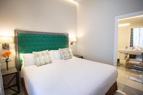 Cama o camas de una habitación en Plazuela del Carbón Suites