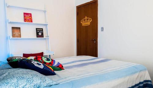 A bed or beds in a room at AP Centro/CidadeBaixa