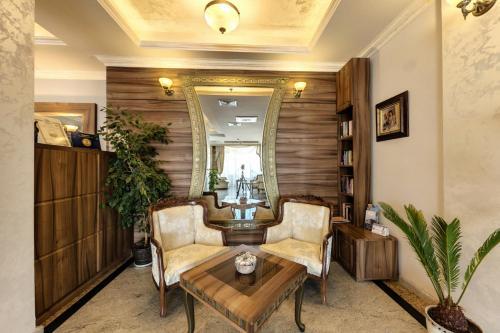 A seating area at Penelopa Palace Apart Hotel & SPA