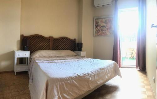 A bed or beds in a room at Lagos Center Studios