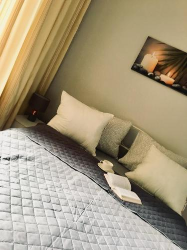 Кровать или кровати в номере Apartamenty Nova Sosnowiec