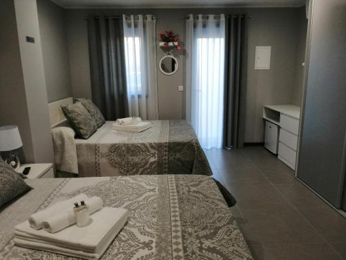A bed or beds in a room at Anevan