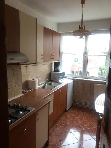 A kitchen or kitchenette at Bright Apartment Near City Center