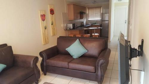 A seating area at Serengeti Self Catering Apartments