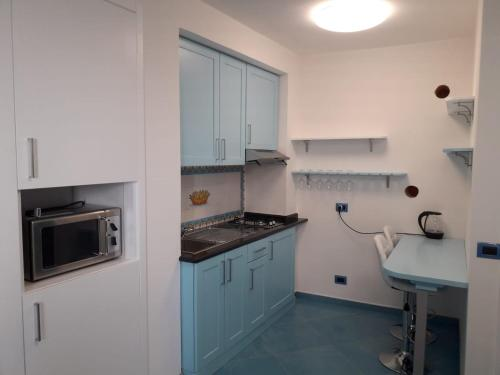 A kitchen or kitchenette at Rifugio Stellato