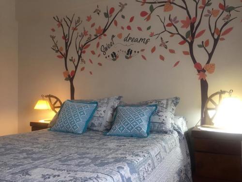 Una cama o camas en una habitación de Let Home Mendoza