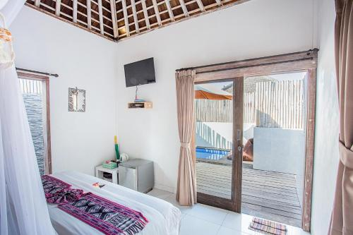 A bed or beds in a room at Svaha Private Villas Ceningan