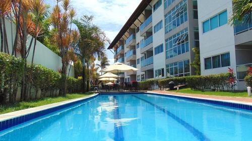 The swimming pool at or near Porto Plaza Flat Porto de Galinhas