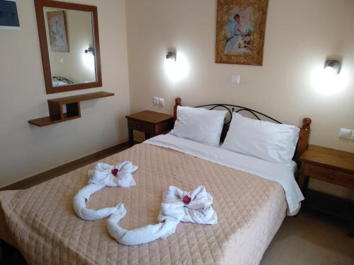 Ένα ή περισσότερα κρεβάτια σε δωμάτιο στο Aiolos Studios