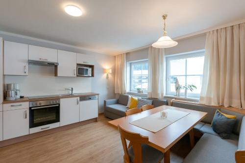 A kitchen or kitchenette at Apartments Stadler