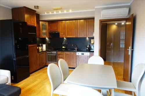 Kuchyň nebo kuchyňský kout v ubytování Apartament X