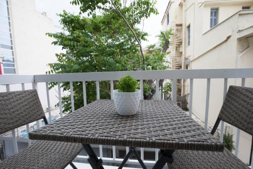 A balcony or terrace at Rastoni Athens Suites near Acropolis at Tsatsou street