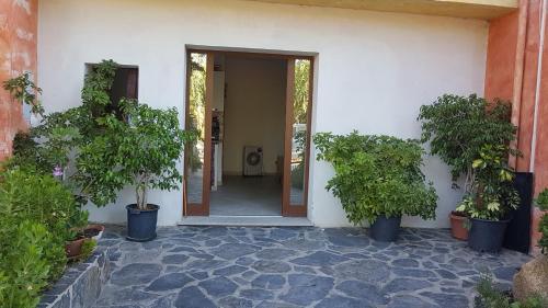 De façade/entree van Casa Terme Romane