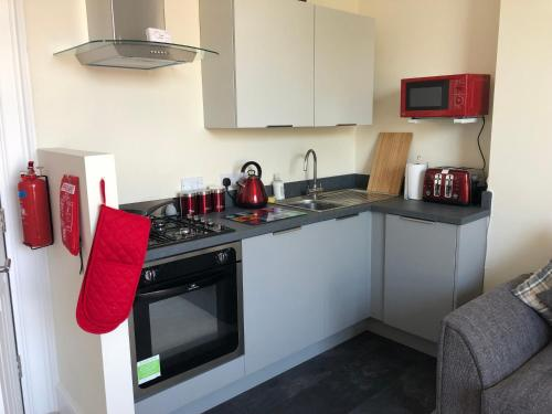 A kitchen or kitchenette at Wight On The Beach, Slps4, Stylish Apartment, Balcony with Sea Views