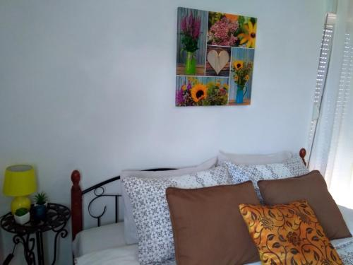 A bed or beds in a room at Apartments Villa Andjela