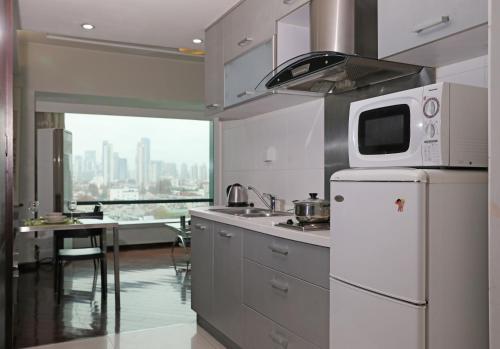 مطبخ أو مطبخ صغير في World Union Service Apartment - Cosmo