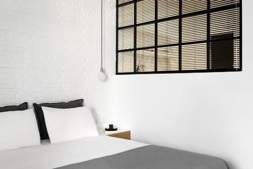 A bed or beds in a room at Athens View Loft 07 & 08
