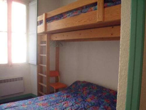A bunk bed or bunk beds in a room at Apartment Angleterre 6