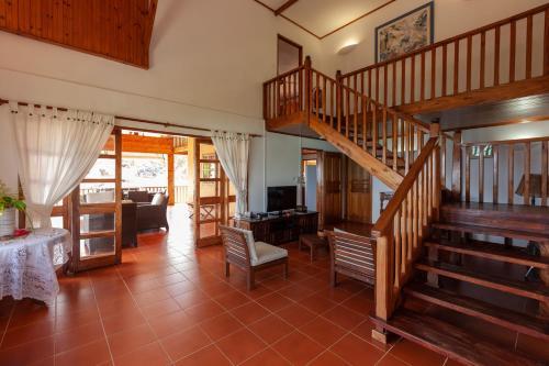 Ein Sitzbereich in der Unterkunft La Villa Mille Etoiles
