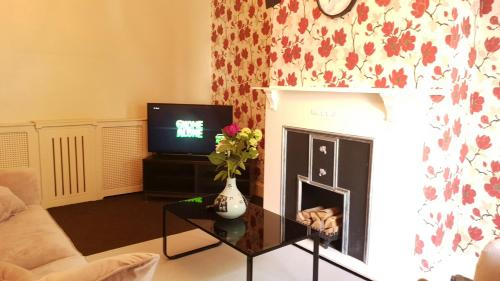 A television and/or entertainment center at Grandeur Holiday home