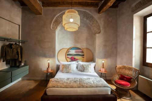 A bed or beds in a room at Palm Suites - Small Luxury Hotels of the World