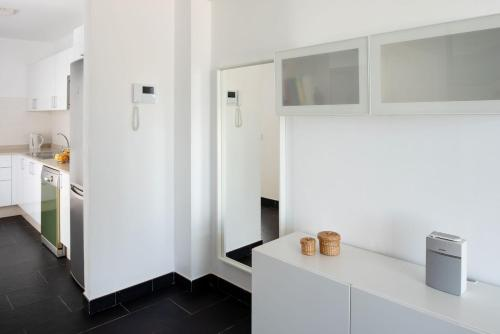 Een keuken of kitchenette bij Villas de la Marina