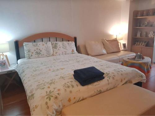 Cama o camas de una habitación en Hug Home I