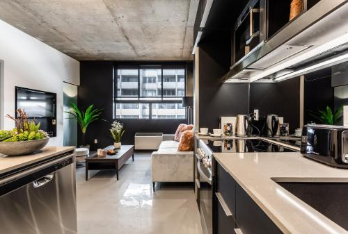 مطبخ أو مطبخ صغير في Pierce Boutique Apartments by Simplissimmo